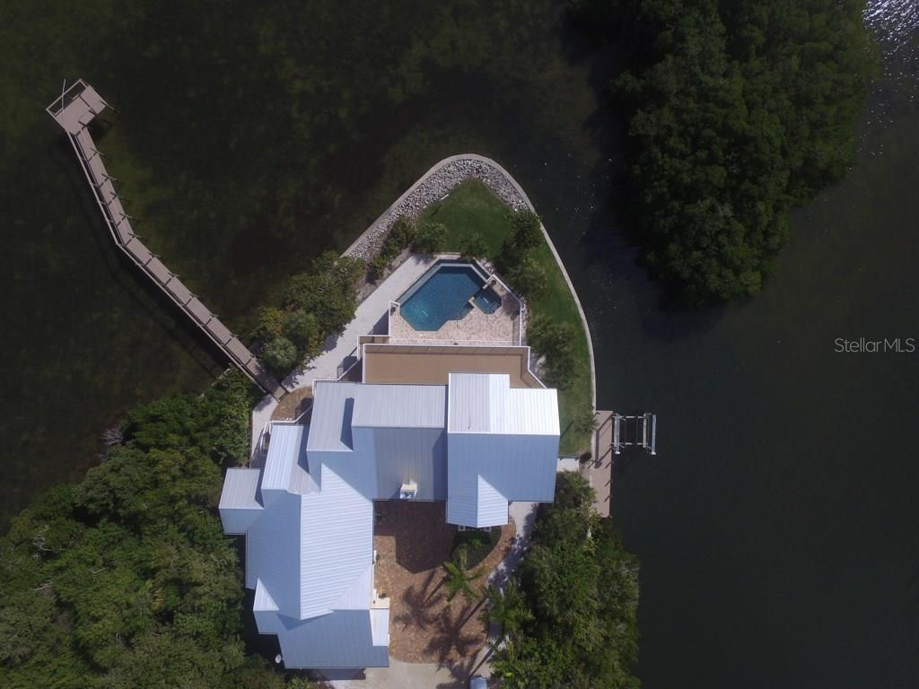 Aerial of Dock and Fishing Pier - Single Family Home for sale at 7295 Manasota Key Rd, Englewood, FL 34223 - MLS Number is D5911936