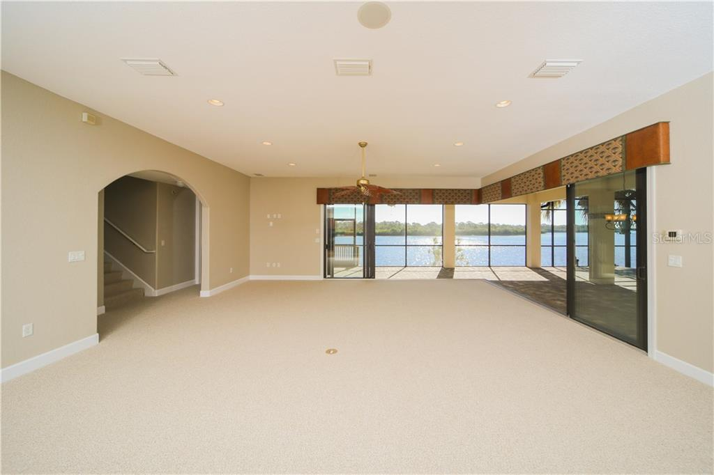 Family Room with Sliders to Lanai. - Single Family Home for sale at 550 Coral Creek Dr, Placida, FL 33946 - MLS Number is D5917129