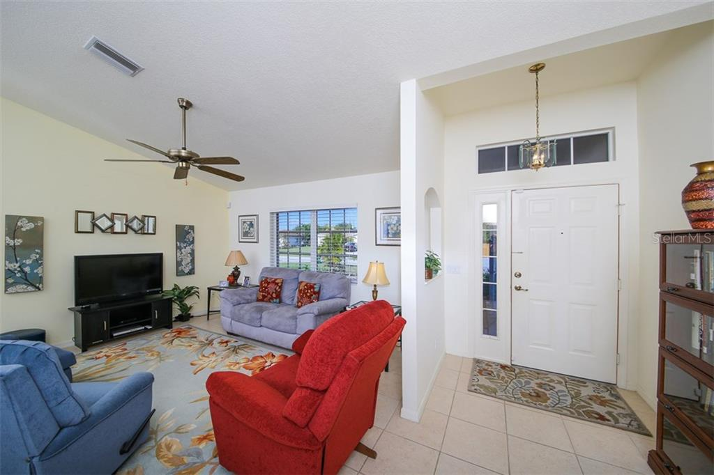 Foyer & Living Room - Single Family Home for sale at 7044 Quigley St, Englewood, FL 34224 - MLS Number is D5918526