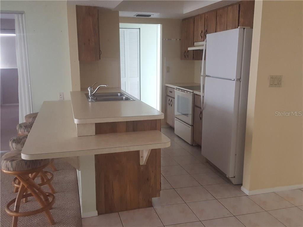 Kitchen. - Single Family Home for sale at 21068 Halden Ave, Port Charlotte, FL 33952 - MLS Number is D5918749