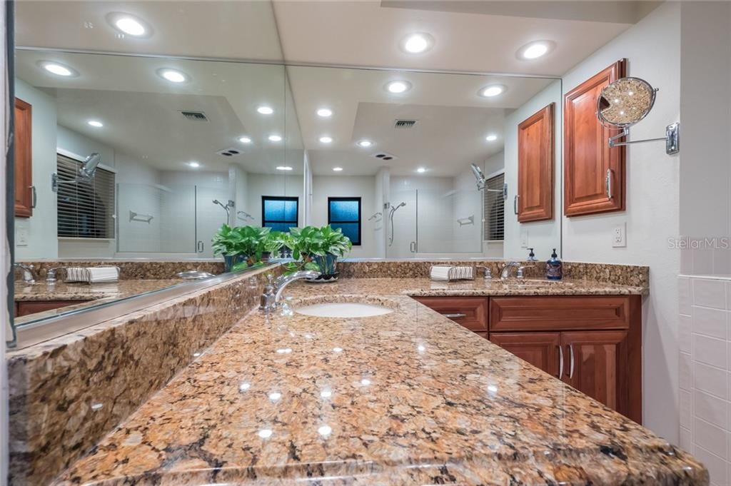 Master bath- granite counters and double sink - Single Family Home for sale at 260 Capstan Dr, Cape Haze, FL 33946 - MLS Number is D5919159