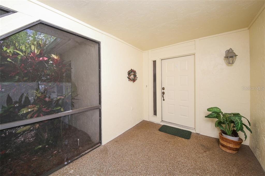 Screened front entrance - Single Family Home for sale at 317 Indian River Ln, Englewood, FL 34223 - MLS Number is D5919375
