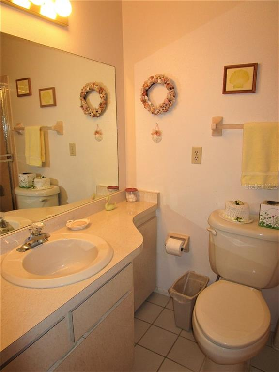 Master bathroom has vanity, combination tub/shower & tiled flooring. - Condo for sale at 6796 Gasparilla Pines Blvd #14, Englewood, FL 34224 - MLS Number is D5919892