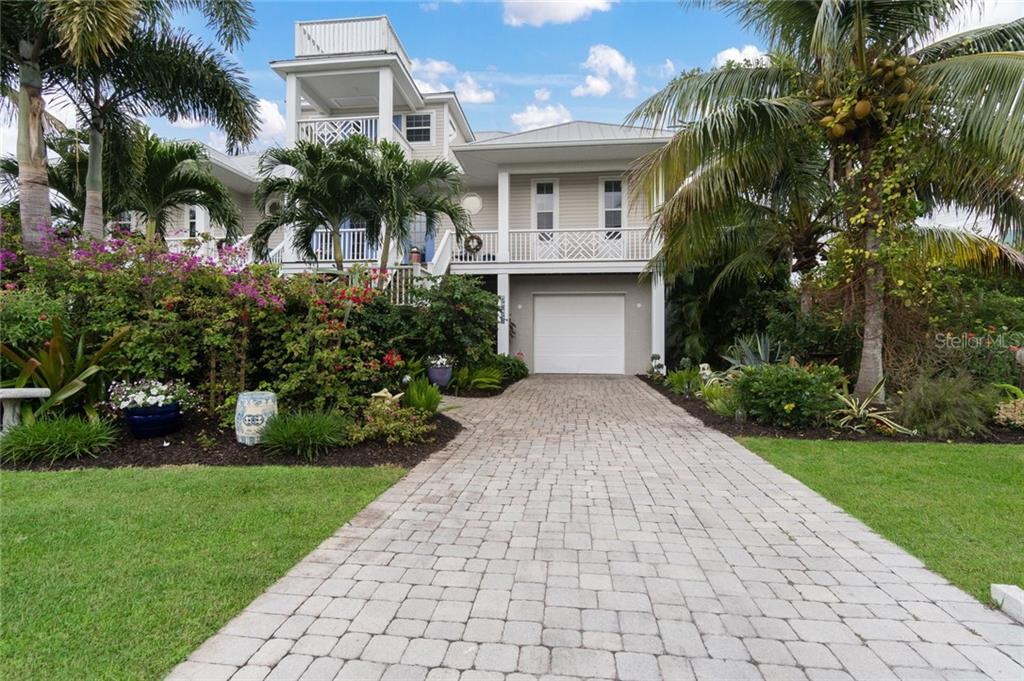 Exterior front - Single Family Home for sale at 9891 Gasparilla Pass Blvd, Boca Grande, FL 33921 - MLS Number is D5920572