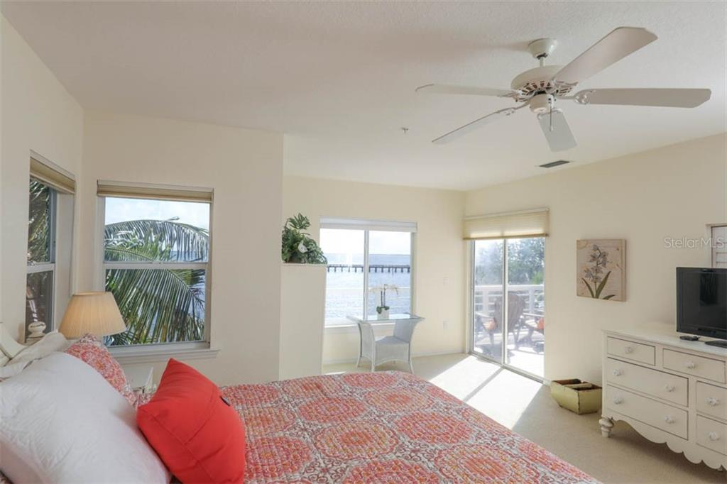 Master showing balcony/sun deck access - Single Family Home for sale at 16740 Grande Quay Dr, Boca Grande, FL 33921 - MLS Number is D5920860