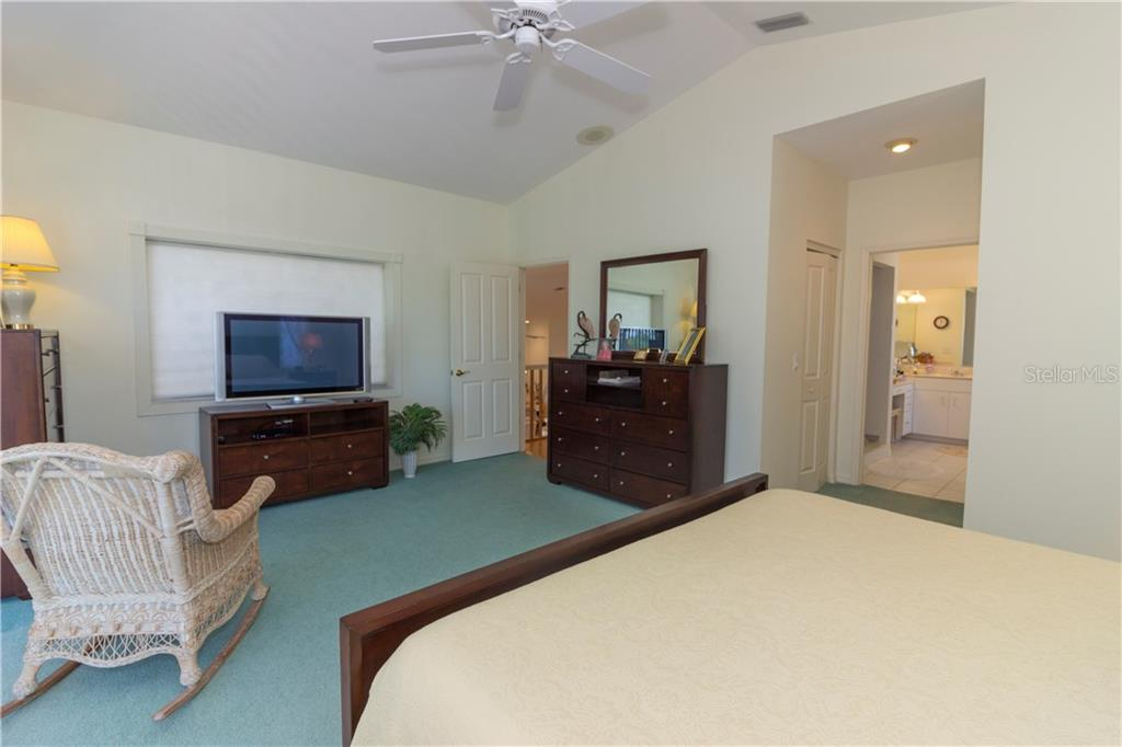 Here is another view of the master bedroom. - Single Family Home for sale at 1439 Deer Creek Dr, Englewood, FL 34223 - MLS Number is D5921060