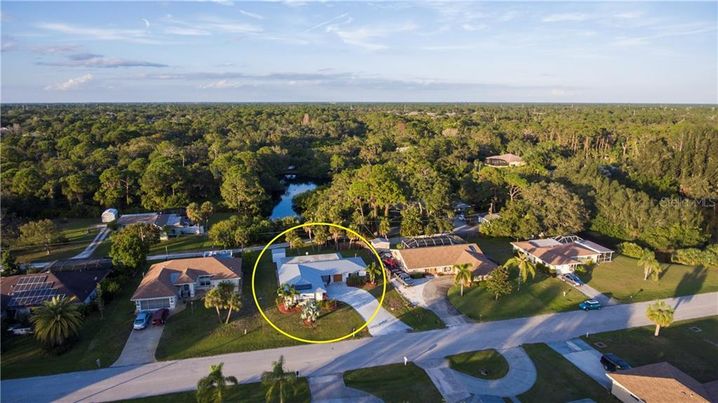 This aerial view shows that privacy of the location - especially looking out the backyard. - Single Family Home for sale at 360 E Wentworth Cir, Englewood, FL 34223 - MLS Number is D5921470