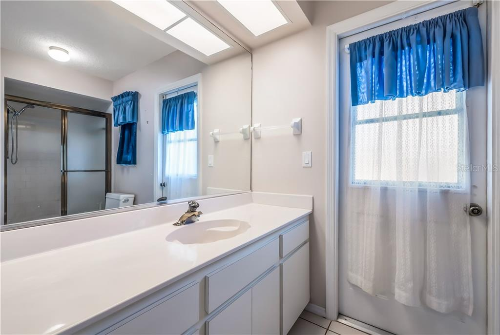 2nd bathroom with direct access from the pool and lanai. - Single Family Home for sale at 11010 Deerwood Ave, Englewood, FL 34224 - MLS Number is D5921766