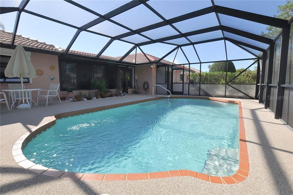 spacious pool lanai area - Single Family Home for sale at 9 Pine Ridge Way, Englewood, FL 34223 - MLS Number is D5921839