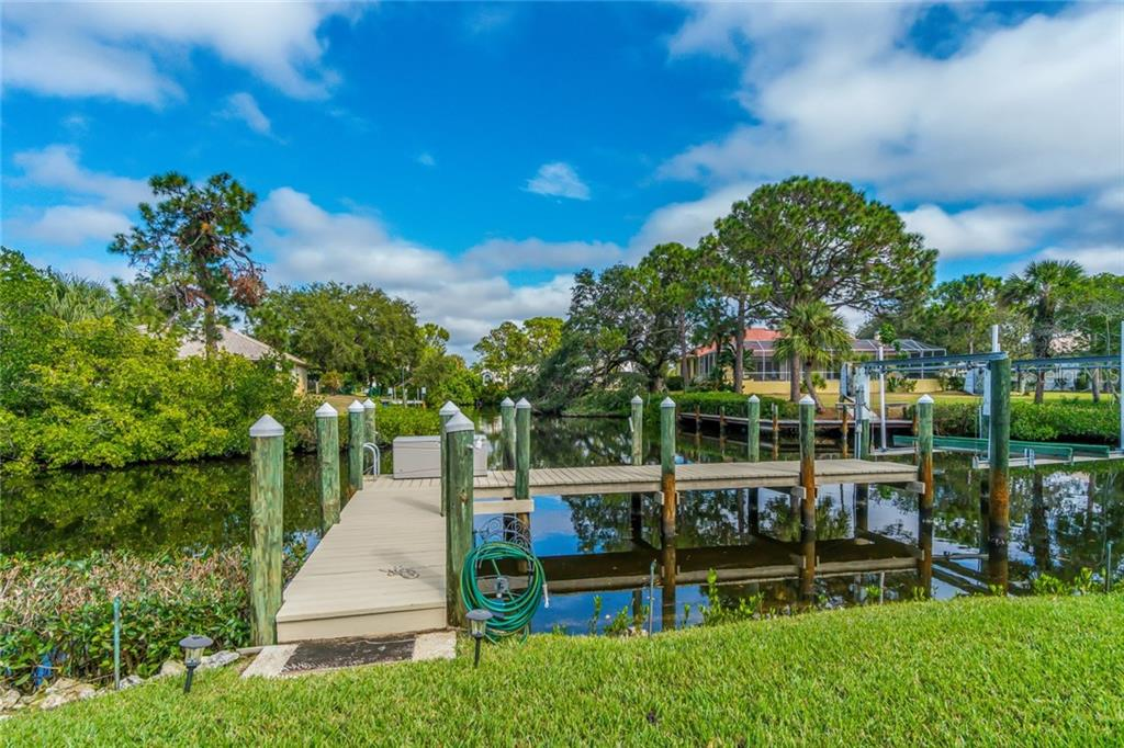 Single Family Home for sale at 10070 Creekside Dr, Placida, FL 33946 - MLS Number is D5922335