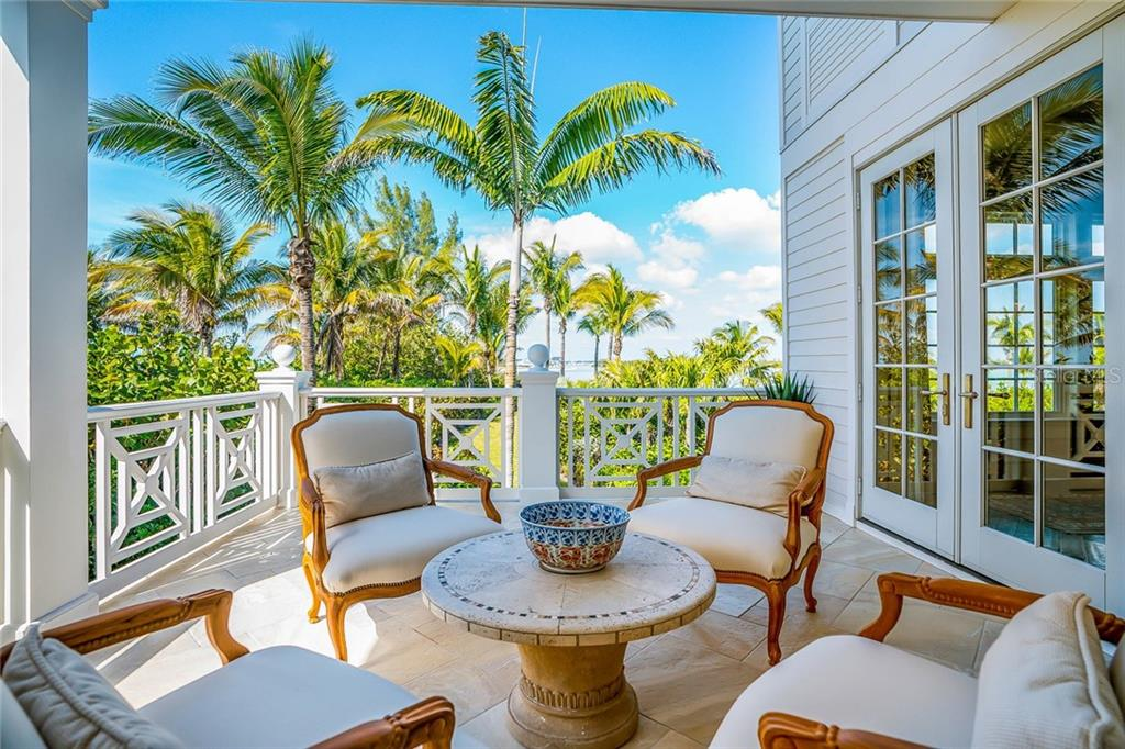 Covered terraces overlooking the gardens - Single Family Home for sale at 16160 Sunset Pines Cir, Boca Grande, FL 33921 - MLS Number is D5922901
