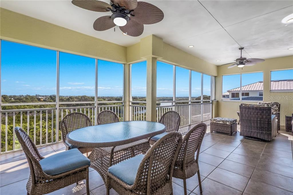 Enormous covered, screened lanai space overlooking Amberjack Environmental Park and Lemon Creek - Condo for sale at 8541 Amberjack Cir #402, Englewood, FL 34224 - MLS Number is D5923680