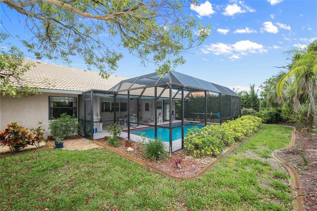 Rear with landscape curbing - Single Family Home for sale at 332 Eden Dr, Englewood, FL 34223 - MLS Number is D6100012
