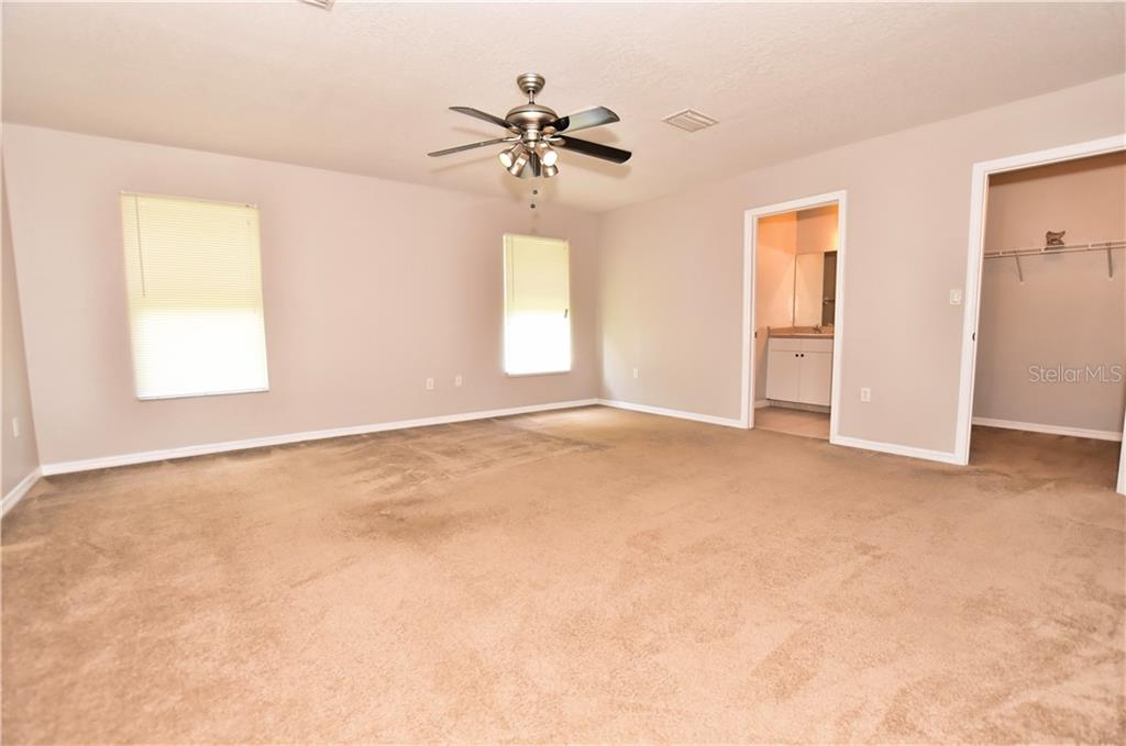 Master bedroom, walk in closet, Master bath with double sinks, shower no tub, and toilet. - Single Family Home for sale at 4414 Callaway St, Port Charlotte, FL 33981 - MLS Number is D6100799