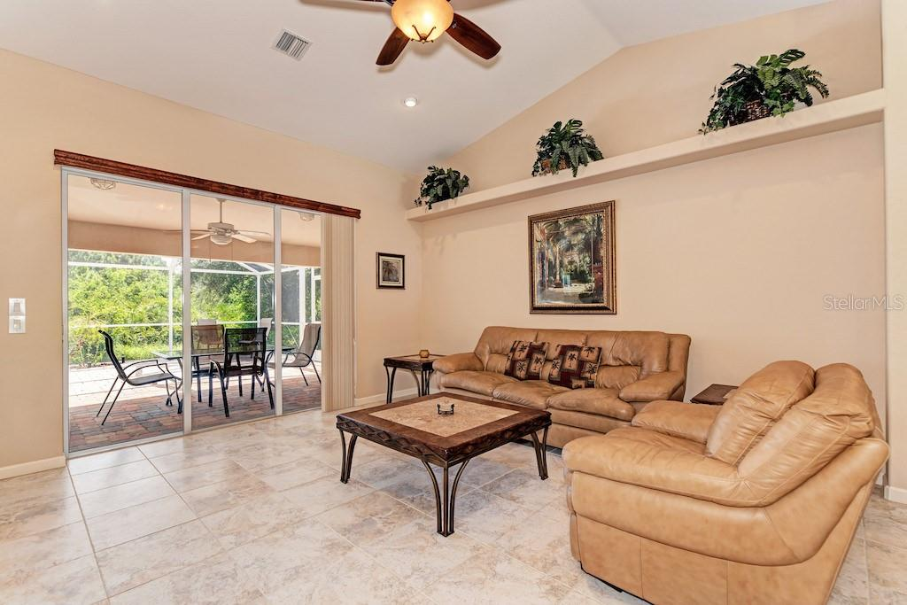 Large ceramic tile in a very spacious great room. - Single Family Home for sale at 7256 Holsum St, Englewood, FL 34224 - MLS Number is D6101787
