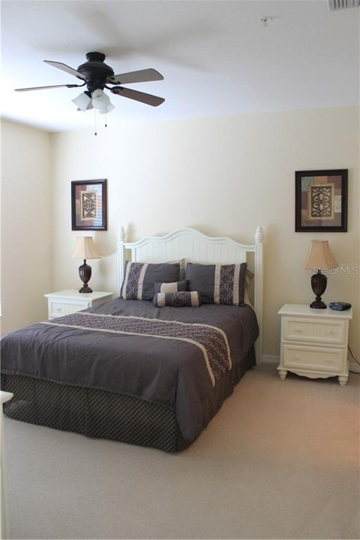 Master bedroom is roomy and offers a large walk-in closet. - Condo for sale at 8409 Placida Rd #403, Placida, FL 33946 - MLS Number is D6102047