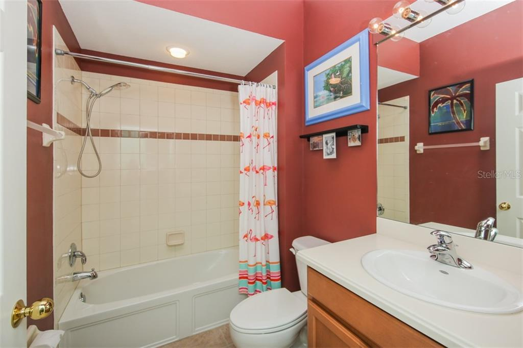 The guest bathroom is quietly tucked away with easy access to your guest bedroom. Your guests will appreciate the elegance and privacy. - Villa for sale at 29704 Niagara Ct, Englewood, FL 34223 - MLS Number is D6102386