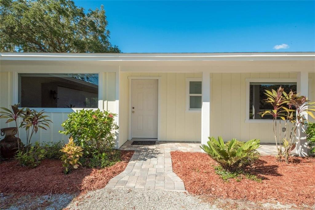 Picture windows take advantage of the lovely views and are all hurricane rated.  Never put up storm shutters! - Single Family Home for sale at 7339 Hawkins Rd, Sarasota, FL 34241 - MLS Number is D6102762