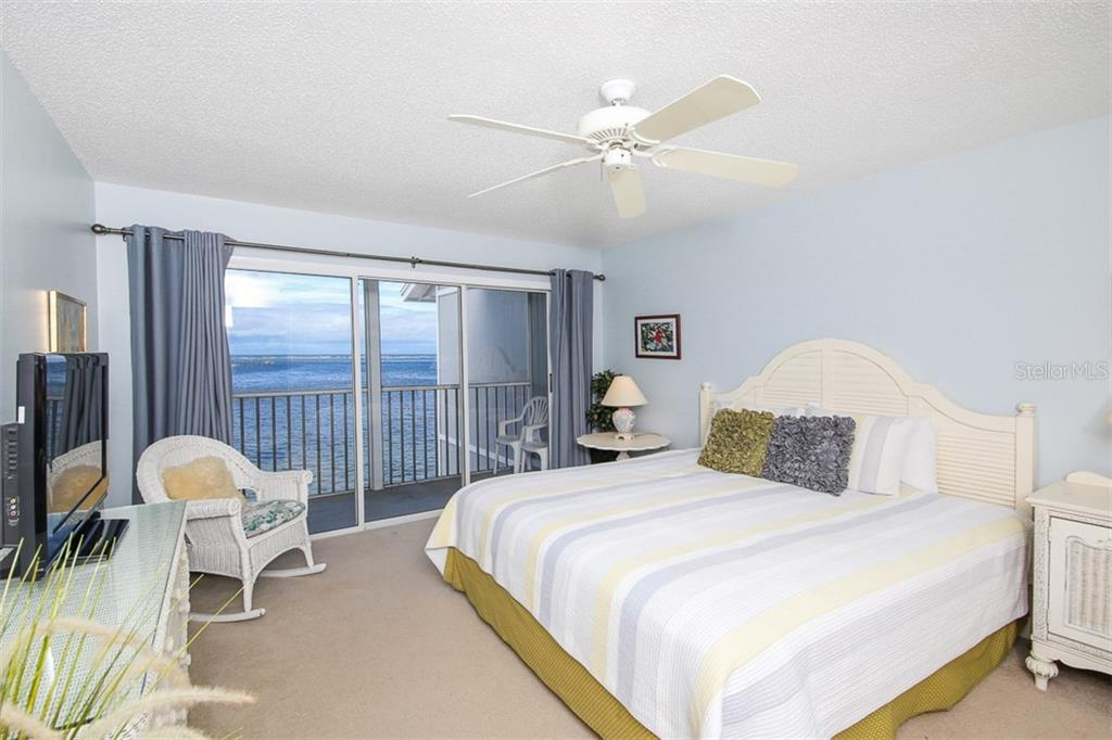 Master bedroom with balcony - Condo for sale at 6001 Boca Grande Cswy #e58, Boca Grande, FL 33921 - MLS Number is D6103590