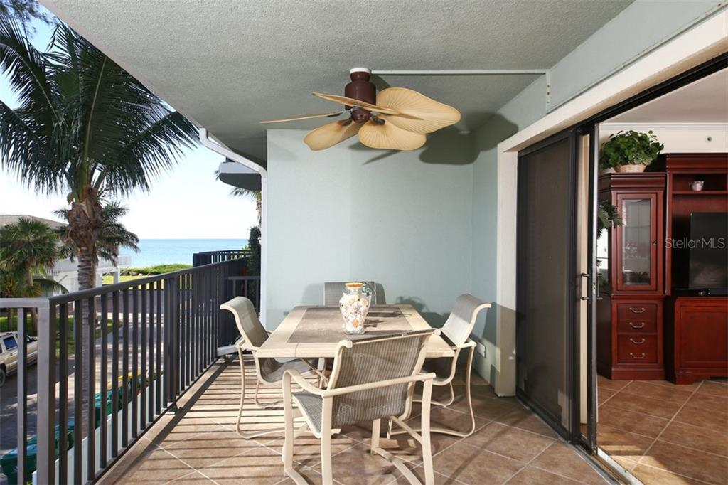 Covered Balcony - Condo for sale at 50 Meredith Dr #8, Englewood, FL 34223 - MLS Number is D6103644