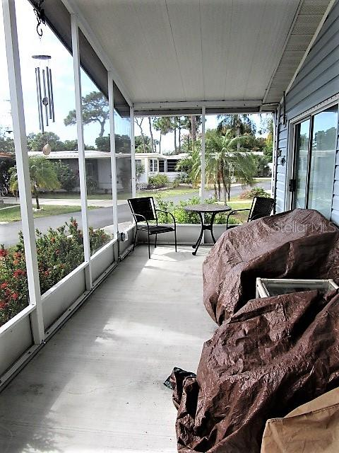 The Screened Front Lanai welcomes all your guests and extends living space outdoors. - Manufactured Home for sale at 1800 Englewood Rd #95, Englewood, FL 34223 - MLS Number is D6103776