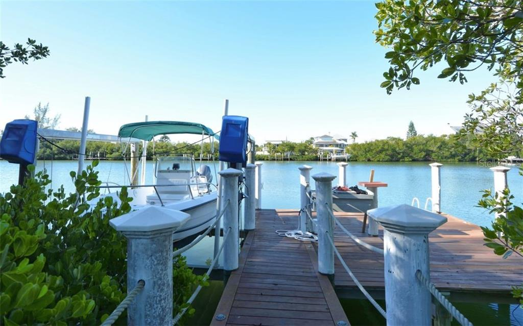 Dock With Lift - Single Family Home for sale at 161 Kettle Harbor Dr, Placida, FL 33946 - MLS Number is D6104075