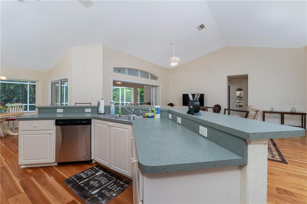Kitchen has a breakfast bar, ceiling fan and breakfast nook. - Single Family Home for sale at 30 Medalist Way, Rotonda West, FL 33947 - MLS Number is D6106239