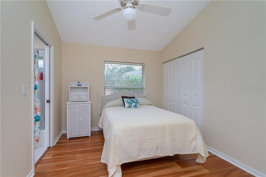 Guest bedroom 2 has wall closet, ceiling fan and access to Guest bath. - Single Family Home for sale at 30 Medalist Way, Rotonda West, FL 33947 - MLS Number is D6106239