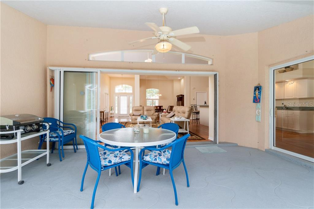 Lanai has two sets of sliding glass doors which can be left open to extend your living space. - Single Family Home for sale at 30 Medalist Way, Rotonda West, FL 33947 - MLS Number is D6106239