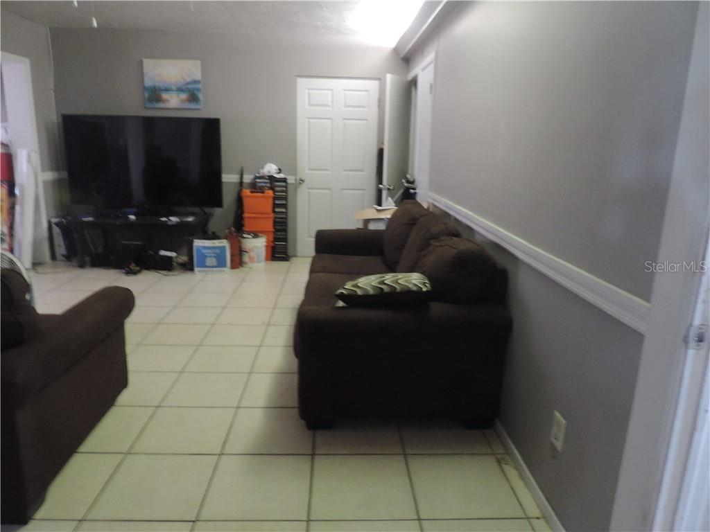 Living Room in Main Area - Single Family Home for sale at 2211 Englewood Rd, Englewood, FL 34223 - MLS Number is D6106456