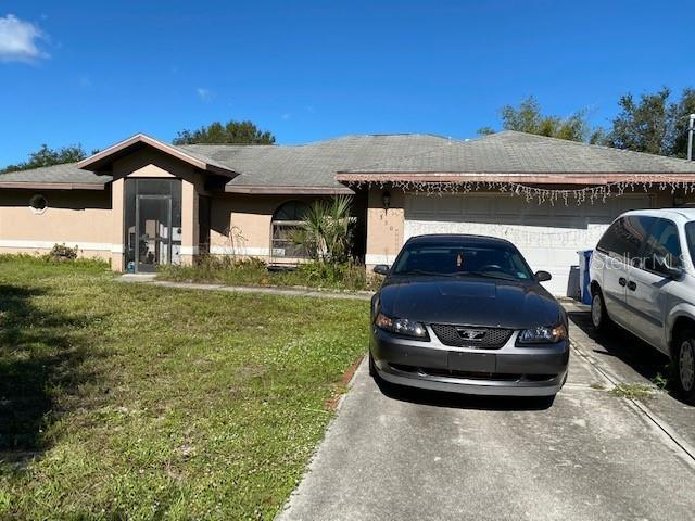 2nd Home Front View - Single Family Home for sale at 2211 Englewood Rd, Englewood, FL 34223 - MLS Number is D6106456