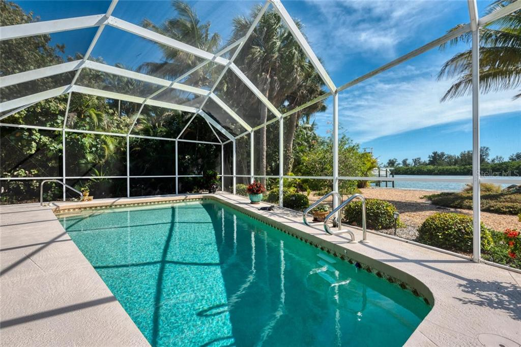 Single Family Home for sale at 315 Green Dolphin Dr, Placida, FL 33946 - MLS Number is D6106672