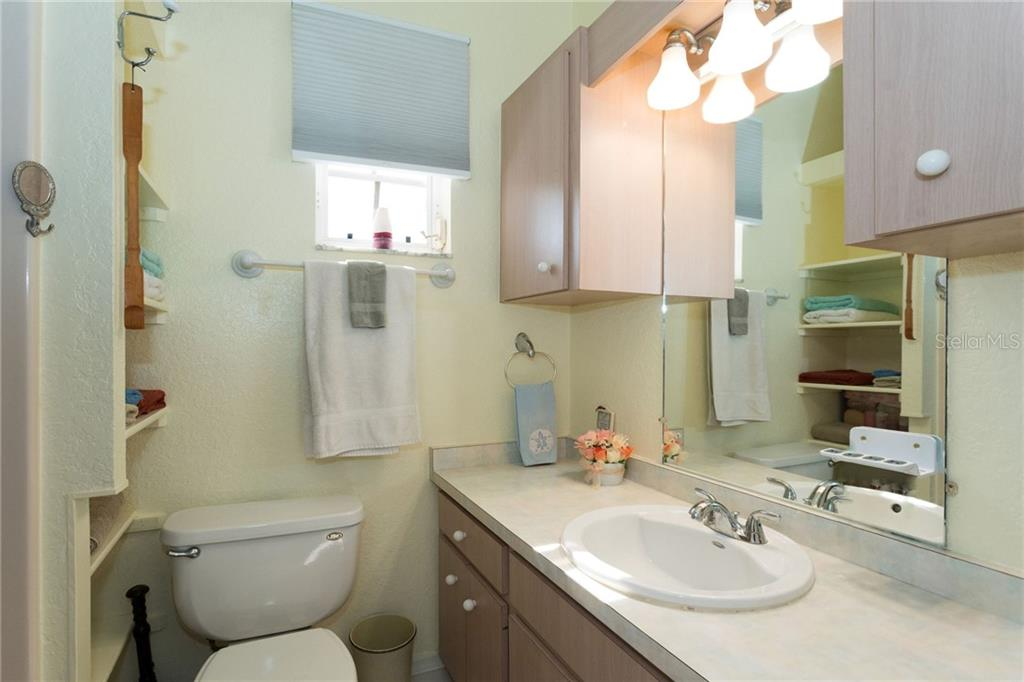 Master bathroom with built in shelving and walk-in shower - Single Family Home for sale at 190 W Wentworth St, Englewood, FL 34223 - MLS Number is D6106918