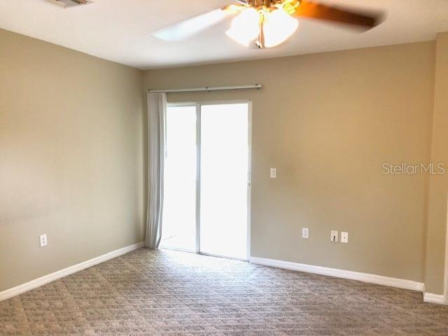 Master Bedroom with sliders to lanai and 2 walk-in closets. - Single Family Home for sale at 2291 Meetze St, Port Charlotte, FL 33953 - MLS Number is D6107685