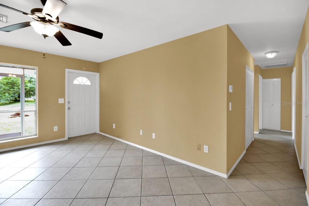 Living room, front entry - Single Family Home for sale at 20233 Peachland Blvd, Port Charlotte, FL 33954 - MLS Number is D6107765
