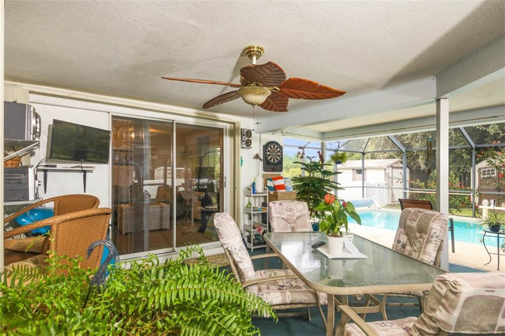covered lanai - Single Family Home for sale at 913 Tropical Ave Nw, Port Charlotte, FL 33948 - MLS Number is D6108061