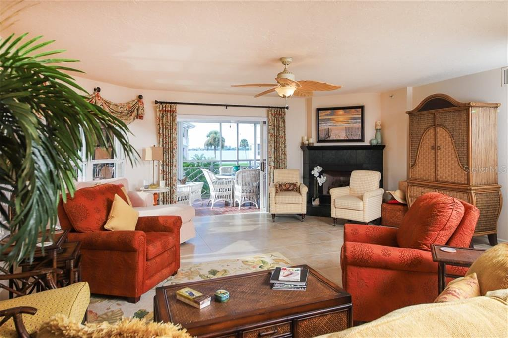 Living Room with peek a boo views of Intracoastal - Condo for sale at 11000 Placida Rd #2301, Placida, FL 33946 - MLS Number is D6108434