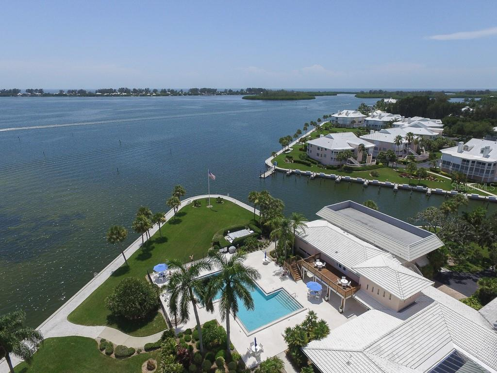 Main clubhouse & pool overlooking Intracoastal - Condo for sale at 11000 Placida Rd #2301, Placida, FL 33946 - MLS Number is D6108434