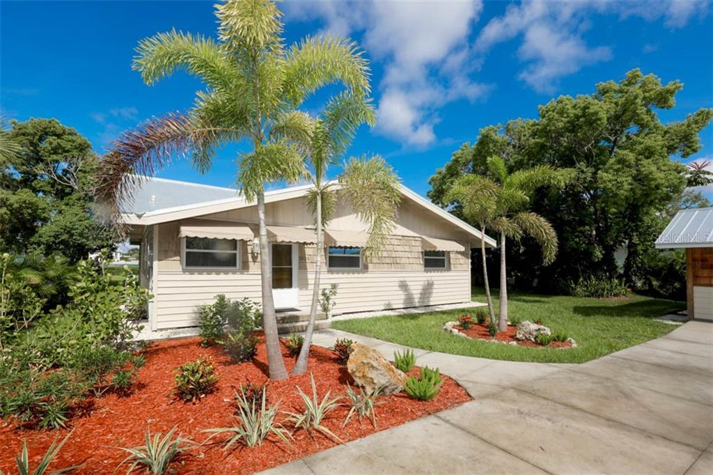 Mature Tropical Landscaping - Single Family Home for sale at 1626 New Point Comfort Rd, Englewood, FL 34223 - MLS Number is D6108454