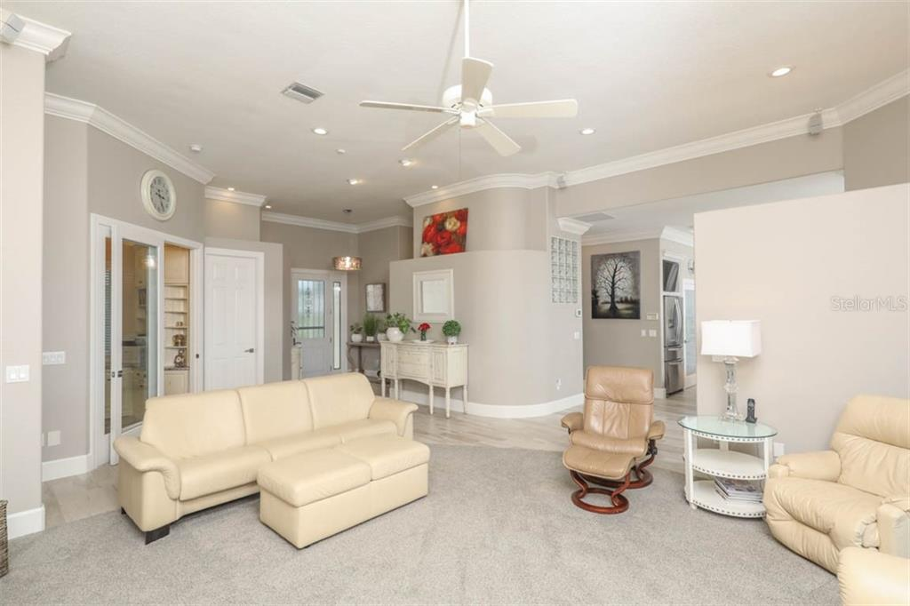 Living Room with Glass Doors to Office/Den - Single Family Home for sale at 1636 New Point Comfort Rd, Englewood, FL 34223 - MLS Number is D6108467