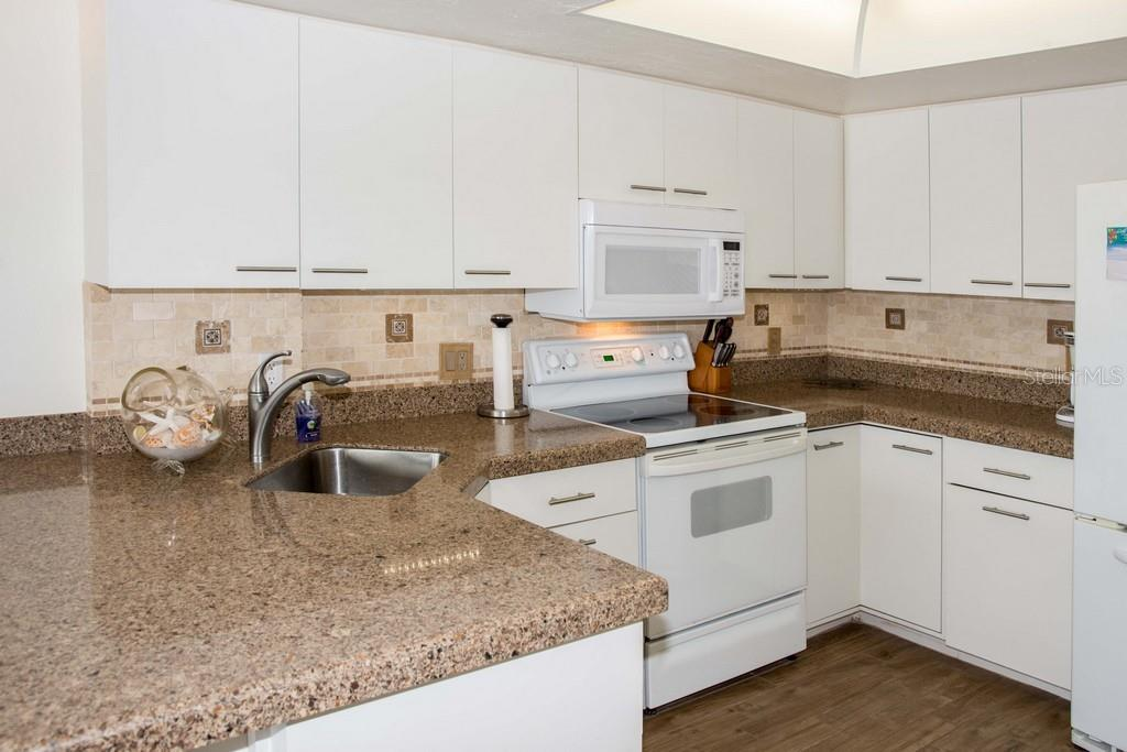 Another view of the kitchen. - Condo for sale at 7070 Placida Rd #1223, Placida, FL 33946 - MLS Number is D6108523