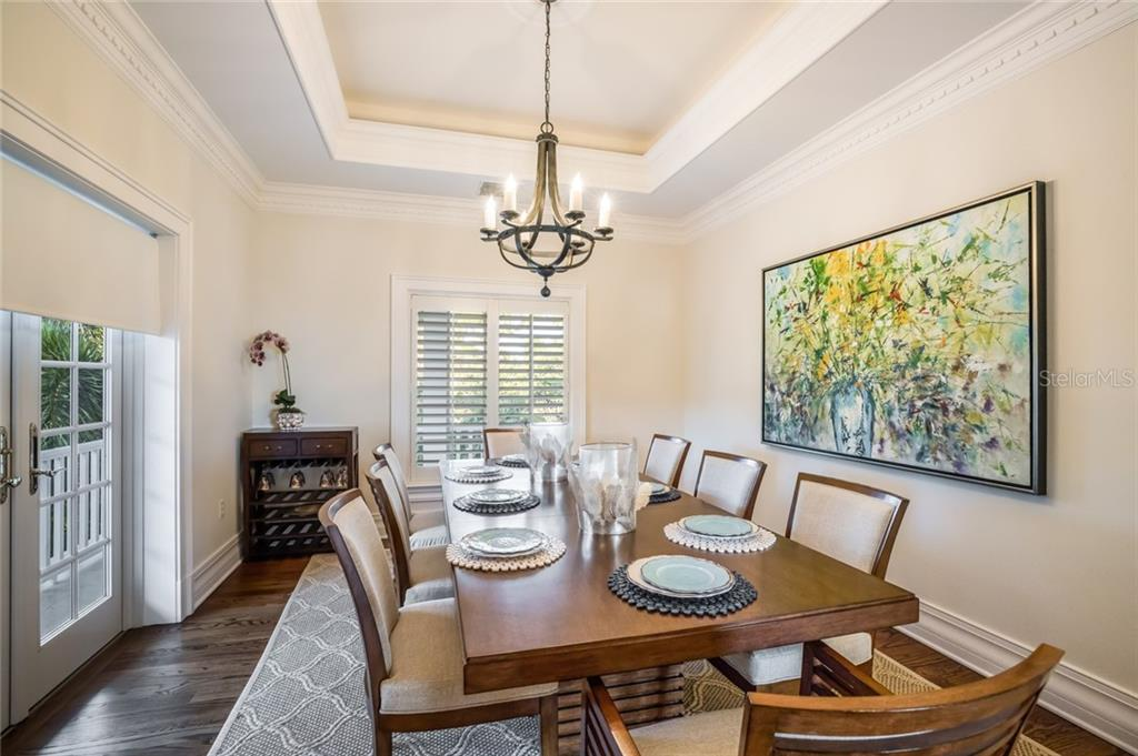 Separate dining room features French doors, custom dentil molding and lighted tray ceiling. - Single Family Home for sale at 1600 E Railroad Ave, Boca Grande, FL 33921 - MLS Number is D6108744