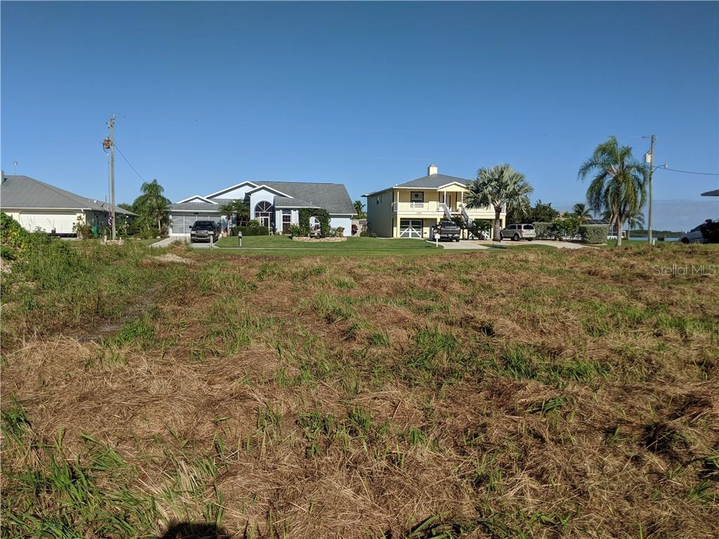 Houses across the street. - Vacant Land for sale at 2400 Vance Ter, Port Charlotte, FL 33981 - MLS Number is D6109360
