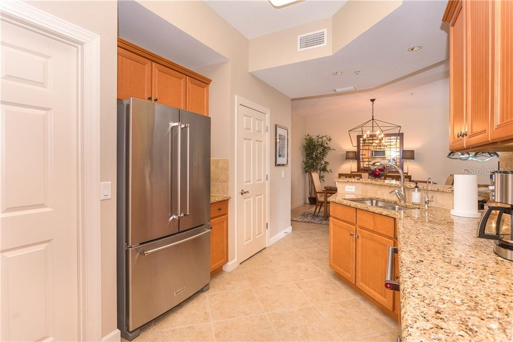 Upgraded Kitchen with KitchenAid Refrigerator - Condo for sale at 8561 Amberjack Cir #202, Englewood, FL 34224 - MLS Number is D6109771
