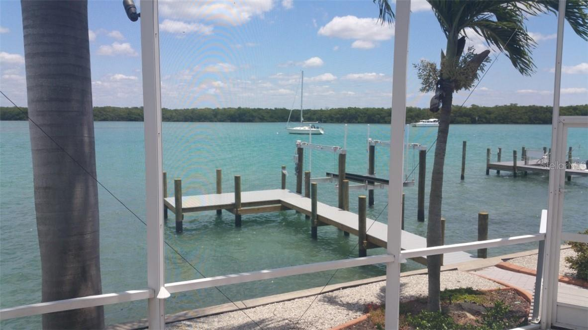 View of Lemon Bay towards Ski Alley from Lanai. Pic shows former dock which has been removed and new dock added. - Single Family Home for sale at 185 Sabal Ln, Englewood, FL 34223 - MLS Number is D6110218