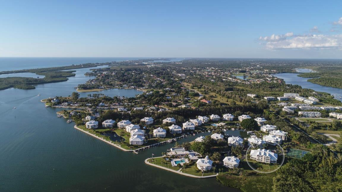 Front aerial view - Condo for sale at 11000 Placida Rd #306, Placida, FL 33946 - MLS Number is D6110298