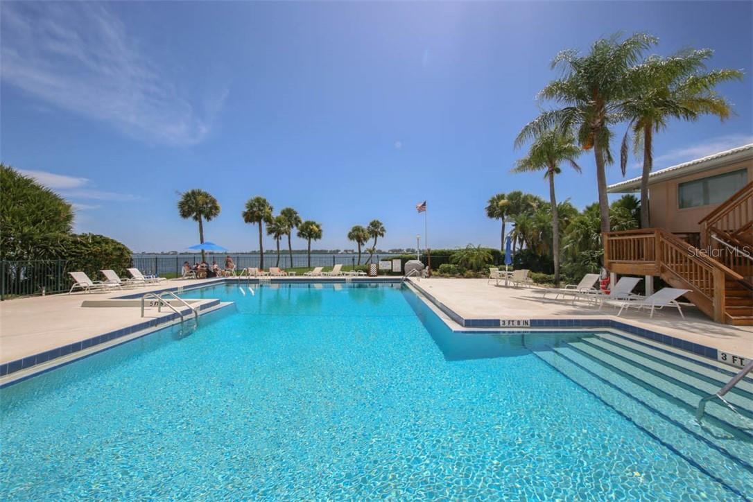 Main pool overlooking Intracoastal - Condo for sale at 11000 Placida Rd #306, Placida, FL 33946 - MLS Number is D6110298