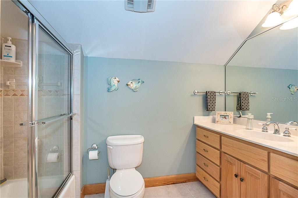 2nd floor bathroom - Single Family Home for sale at 550 S Oxford Dr, Englewood, FL 34223 - MLS Number is D6111512