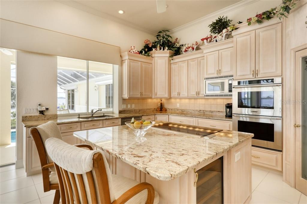 KITCHEN - WOLF STOVE TOP AND REFRIGERATOR - Single Family Home for sale at 6793 Manasota Key Rd, Englewood, FL 34223 - MLS Number is D6112093