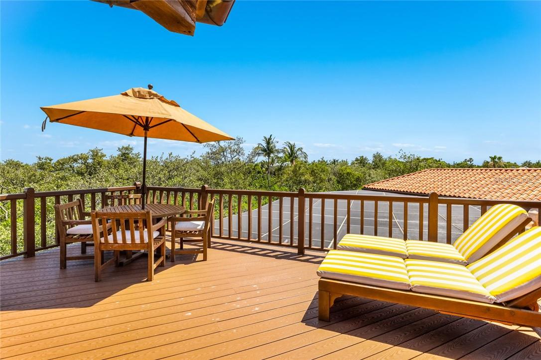 Sun deck off of the living room with outdoor dining - Single Family Home for sale at 4090 Loomis Ave, Boca Grande, FL 33921 - MLS Number is D6112331